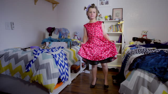 8 year old boy in make up and red dress