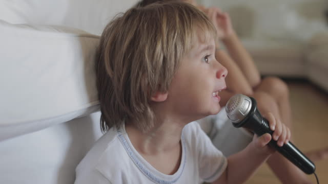 6 year old boy play with his brother - microphone stock videos & royalty-free footage