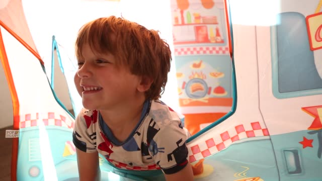3 year old boy playing in play house - playhouse stock videos and b-roll footage