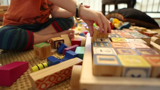 4 year old boy playing with wooden blocks - arranging stock videos and b-roll footage