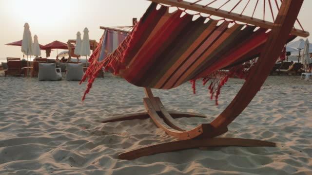 6 year old boy sitting on a hammock on the beach - hammock stock videos & royalty-free footage