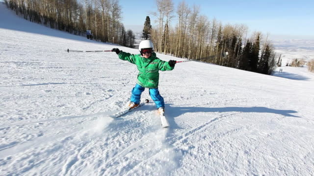 ms pov 10 year old boy skiing backwords down ski run / park city, utah, united states - skifahren stock-videos und b-roll-filmmaterial