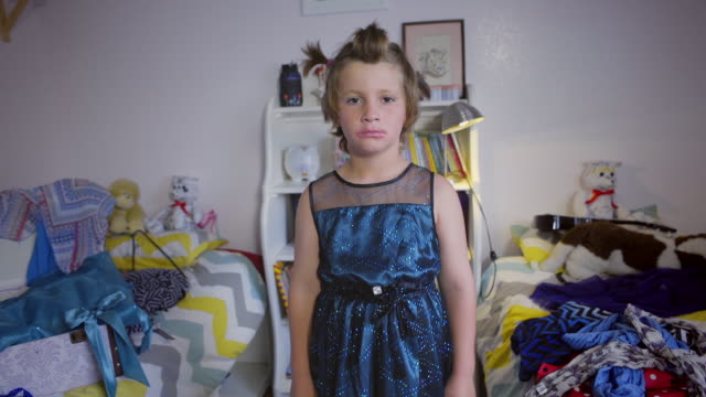8 year old boy spins in his shiny blue dress and high heels