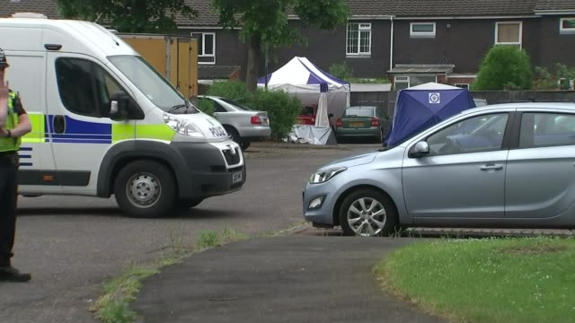 15 year old boy stabbed to death in wolverhampton england west midlands wolverhampton ext blue and white forensic tent over car pull out police... - ロープ仕切り点の映像素材/bロール
