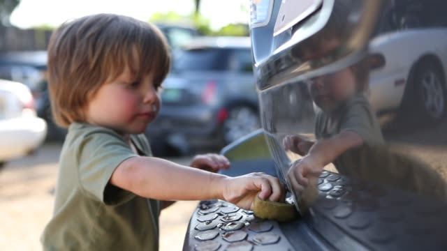 2 year old boy washing a car with his grandfather - bumper stock videos & royalty-free footage