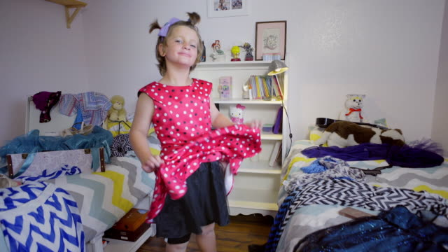 8 year old boy wearing make-up and red dress - Camera moves in