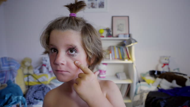 8 year old boy wearing make-up puts on some eye shadow - genderblend stock videos & royalty-free footage