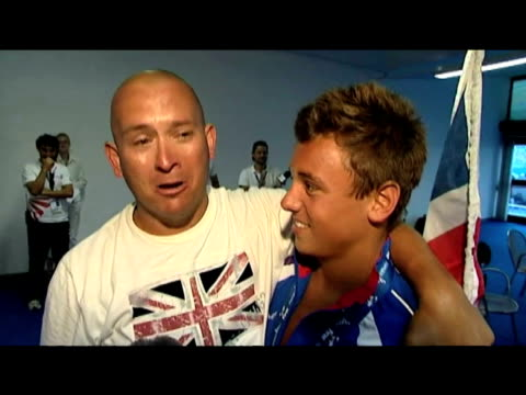 15 year old british diving champion tom daley is hugged by his proud father after winning gold at world championships rome 20 july 2009 - embarrassment stock videos & royalty-free footage