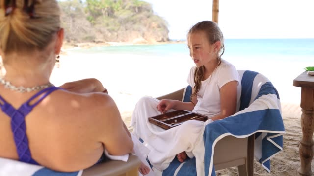 9 year old gir and mother playing - outdoor chair stock videos & royalty-free footage