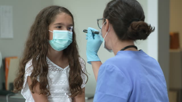 12 year old girl at doctors appointment wearing a protective face mask - pediatrician stock videos & royalty-free footage