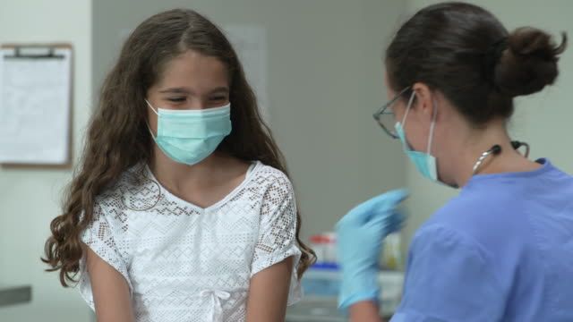 12 year old girl at doctors appointment wearing a protective face mask - fatcamera stock videos & royalty-free footage