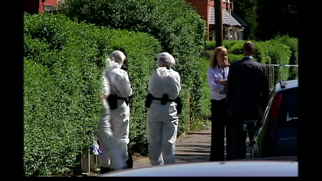 year old girl becomes latest victim of gun crime; england: manchester: gorton: ext police, forensics officers and police cordon outside home of... - toy gun stock videos & royalty-free footage