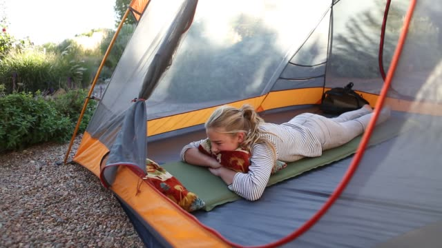 11 year old girl in tent - pillow stock videos and b-roll footage