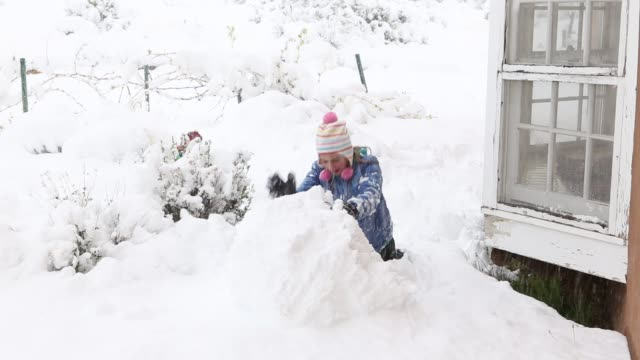 11 year old girl making a snowball - making a snowman stock videos & royalty-free footage