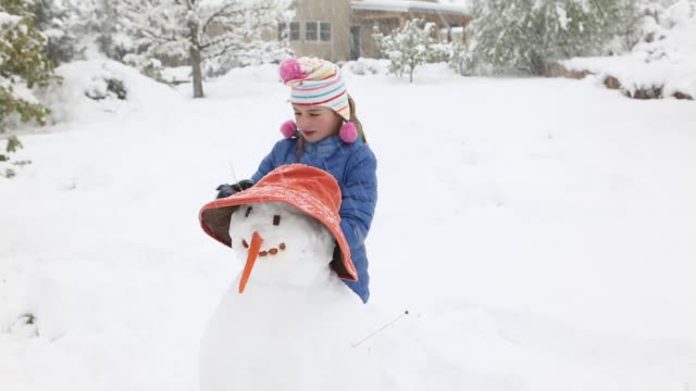11 year old girl making a snowman - making a snowman stock videos & royalty-free footage