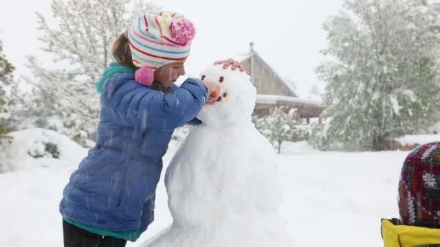 11 year old girl making a snowman