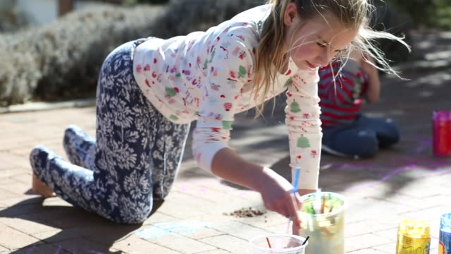 10 year old girl painting on bricks - tracksuit bottoms stock videos & royalty-free footage