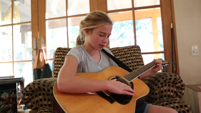 11 year old girl playing guitar - one girl only stock videos and b-roll footage