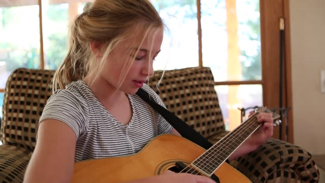 11 year old girl playing guitar - pre adolescent child stock videos and b-roll footage