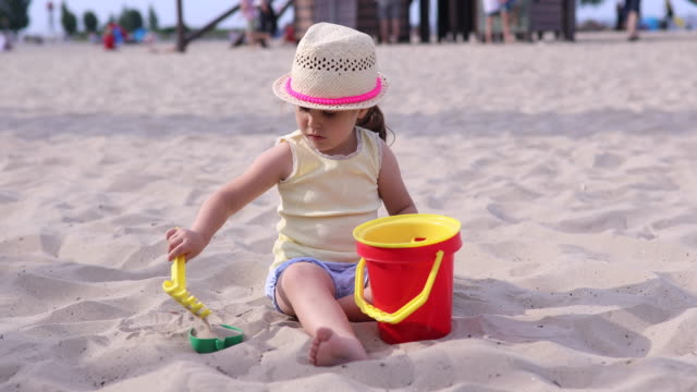 3 year old girl playing in sand