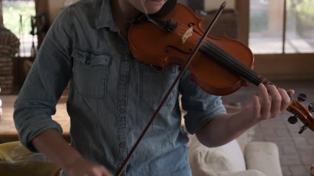 12 year old girl playing violin at home - violin stock videos & royalty-free footage