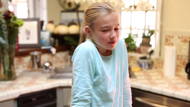 9 year old girl stirring batter in the kitchen