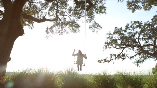 8 year old girl swinging on a swing in the marsh low country