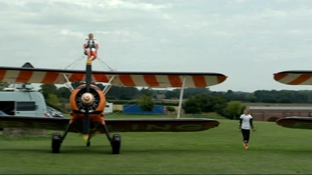 year old girls wing walk for charity; england: gloucester: cirencester: ext 9-year-old friends flame brewer and rose powell preparing to wing walk to... - biplane stock videos & royalty-free footage