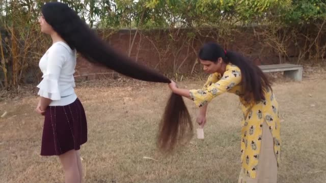year old indian girl has retained her crown as the teen with the world's longest hair more than a decade after she stopping getting her tresses cut... - human hair stock videos & royalty-free footage