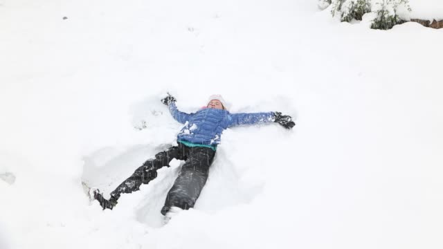 11 year old making a snow angel