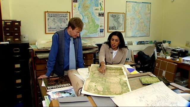 700 year old map of britain found england oxford bodleian library int setup shots of nick millea and reporter looking at map nick millea interview... - bodleian library stock videos and b-roll footage