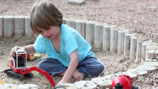 3 year old playing - dump truck stock videos and b-roll footage