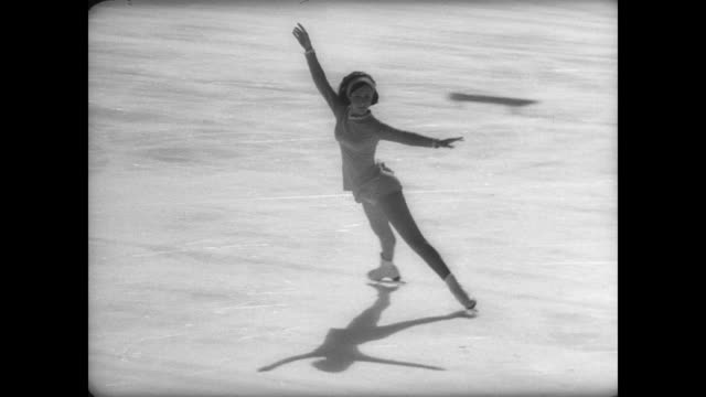 vidéos et rushes de year old rising star, peggy fleming, skates on the ice at the women's world figure skating championship in davos, swizerland / crowd applaud as... - composition florale