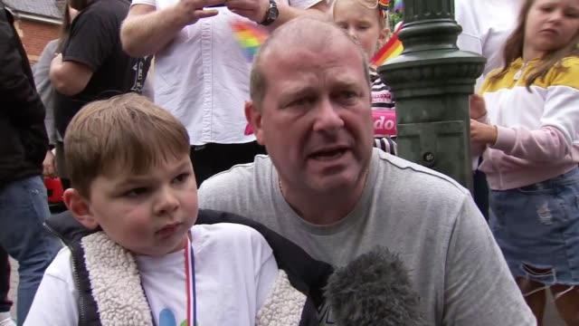 year old tony hudgell raises over a million pounds walking 10 kilometres on crutches for evelina children's hospital; england: kent: kings hill: int... - leggings stock videos & royalty-free footage