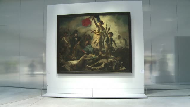 vídeos de stock e filmes b-roll de a 28 year old woman took a marker to the famous delacroix painting liberty leading the people at the louvres satellite museum in lens thursday... - portadas