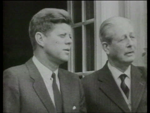 30 year rule papers opened 1963 pres john f kennedy out tx 21463 building with then uk pm harold itn macmillan b/w cms slomo both standing chatting... - big mac stock videos and b-roll footage