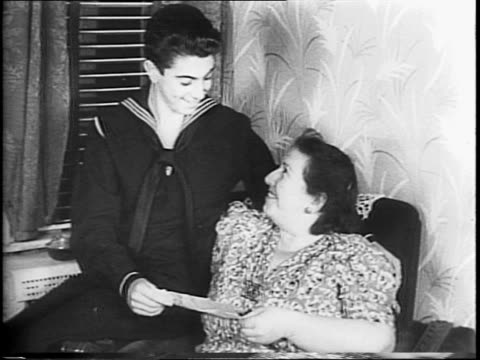 year-old sailor boy norman saul walks down sidewalk, boys greet him, he walks up steps to home / in armchair next to his aunt mrs eva gerban /... - aunt stock videos & royalty-free footage