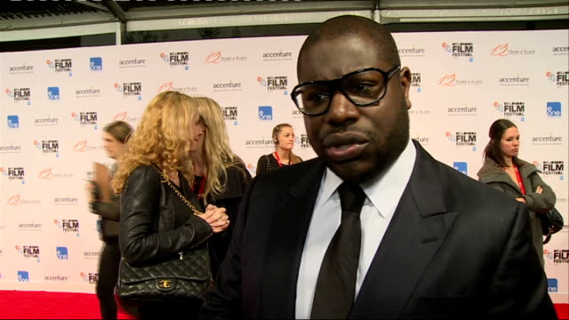 12 Years A Slave Premiere interviews ENGLAND London EXT '12 Years a slave' sign / people posing on red carpet / Chiwetel Ejiofor on red carpet /Steve...
