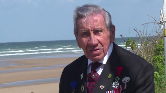 75 years after dday charles norman shay an amerindian belonging to the penobscot tribe returns to omaha beach and remembers june 6 1944 - omaha beach stock videos and b-roll footage