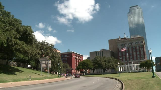 years after jfks assassination, the infamous dealey plaza in dallas has become an atmospheric crossroads for tourists, conspiracy theorists and... - infamous stock videos & royalty-free footage