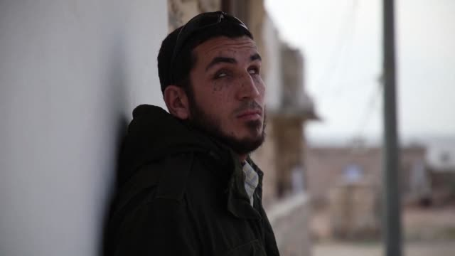 years after losing his eyesight in battle former syrian rebel fighter ahmad talha hunches over his mobile phone in a bare classroom listening to the... - blindness stock videos & royalty-free footage