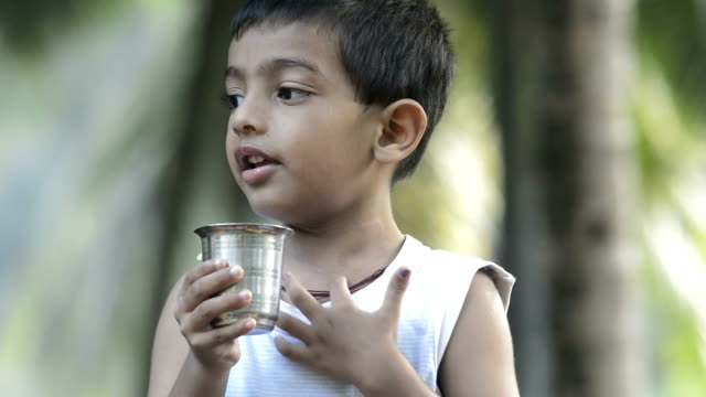 4 years boy drinking water
