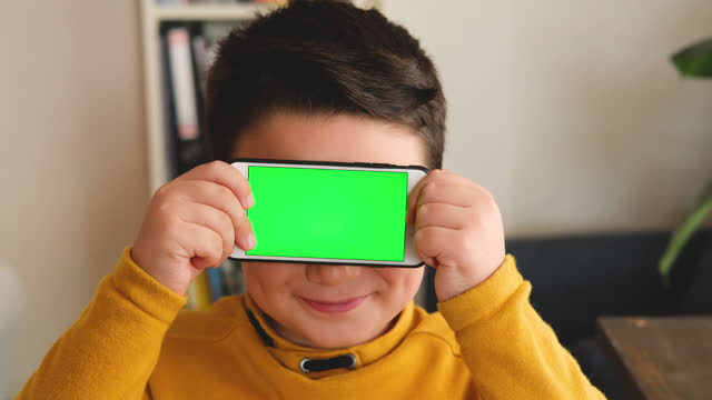6-7 years child holding and touching, smart phone. smart phone screen is empty. - 6 7 years stock videos & royalty-free footage
