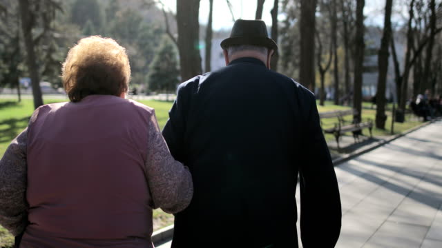 60 years in marriage.elderly couple walking in the spa park - loyalty stock videos & royalty-free footage