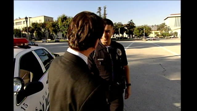 dividing a country; usa: california: ext irvine along and shakes hands with joaquin irvine and joaquin walking and talking joaquin gurrola interview... - irvine verwaltungsbezirk orange county stock-videos und b-roll-filmmaterial