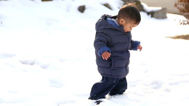 1.3 years old asian baby boy playing in the snow first time. - june stock videos & royalty-free footage