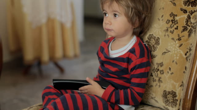 2 years old boy holding a tv remote control - 2 3 years stock videos & royalty-free footage