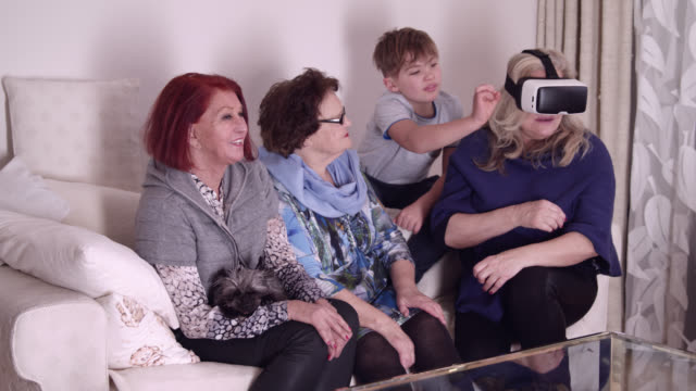 9 years old boy teaches grand mother and great grandmother (90 years old) and a 70 years old lady how to use VR glasses
