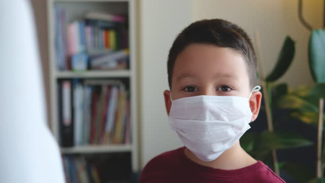 6-7 years old cute child at home for social distancing. he is boring but necessary for protection from coronavirus. - 6 7 years stock videos & royalty-free footage