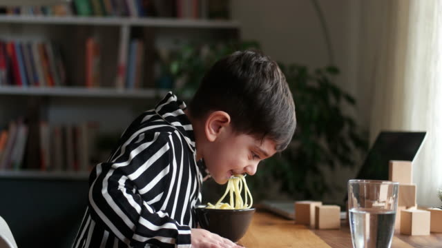 2-3 years old cute child eating spaghetti. he is happy. - 2 3 years stock videos & royalty-free footage